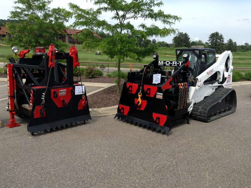 Custom Made Bobcat Attachment Can Tow Loaded 18 Wheelers