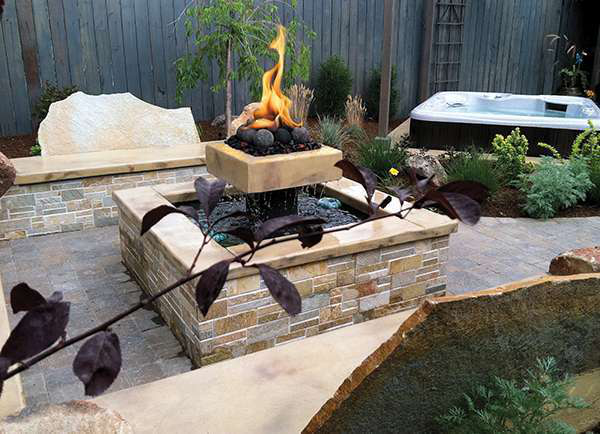 The fire/water features was combined to save space in this small backyard.