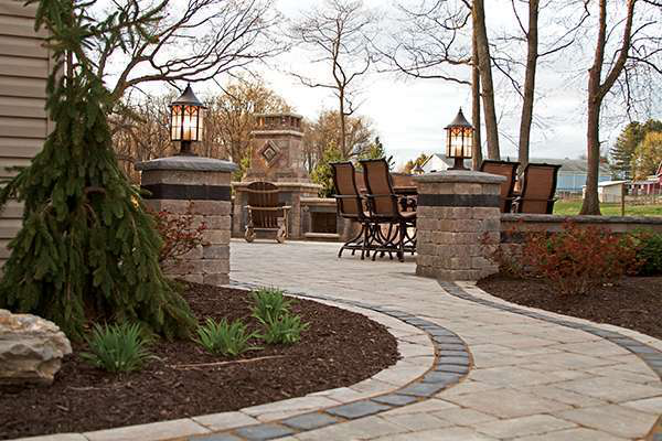 bolder concepts landscape design used unilock brussels pavers and wall blocks with unilock courtstone banding - Unilock Patio Designs