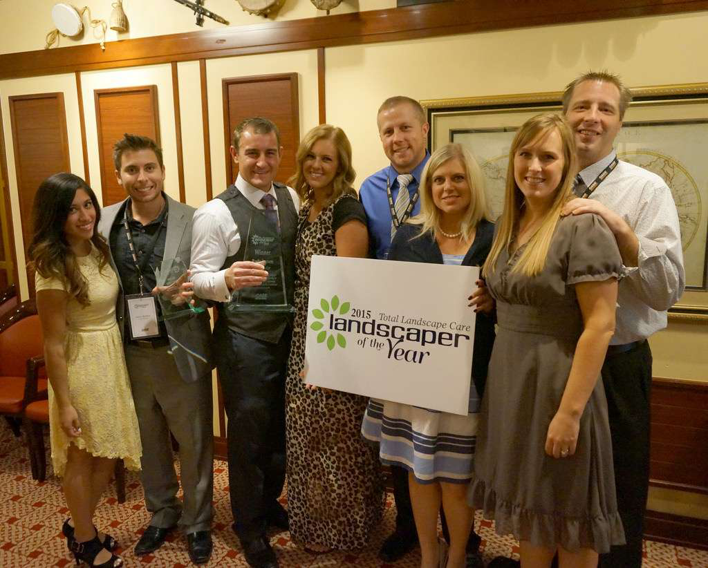 Rudy Larsen, third from the left, and his team celebrated winning the Landscaper of the Year.