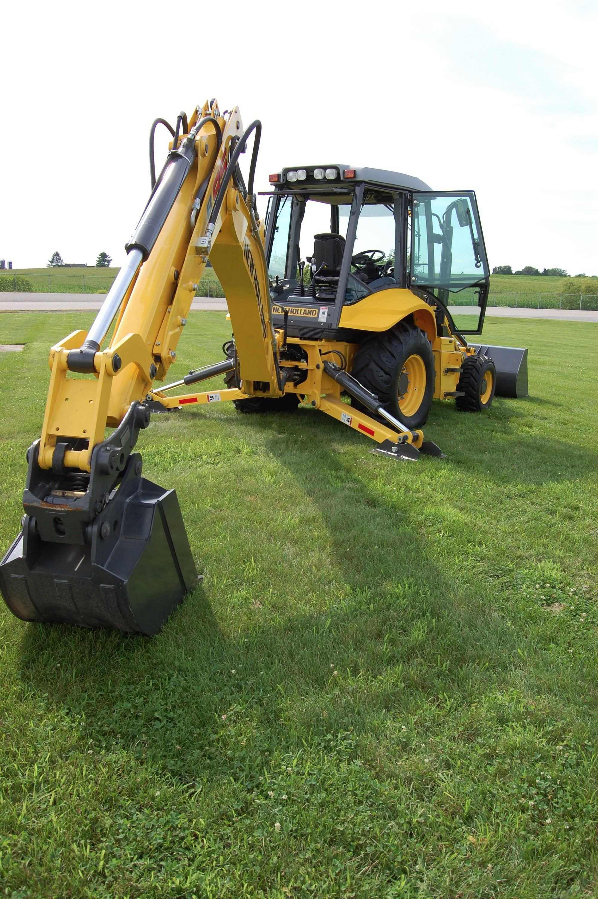 New Holland Touts Upgrades To Backhoe Skid Steer Lines