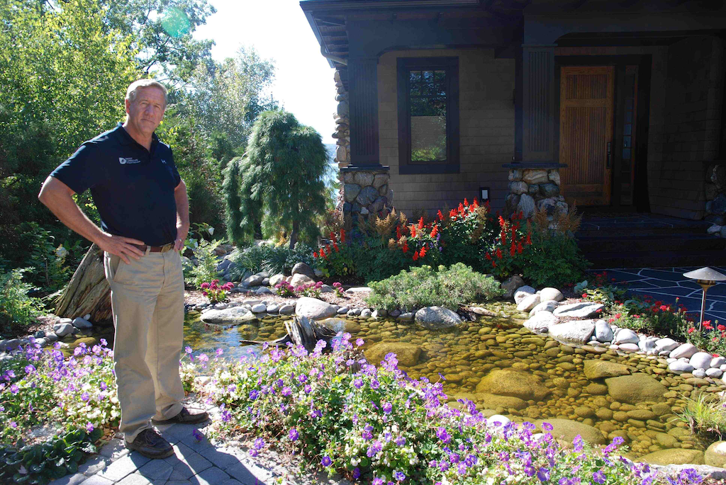 Standing beside one of the water features for which his company is known, Bob Drost is quick to credit his success to the talent and drive of his employees. Photo: Lauren Heartsill Dowdle