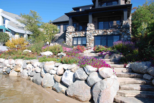 In this project, the use of large stones in the landscape design echoes the architecture of the home. Photo: Lauren Heartsill Dowdle