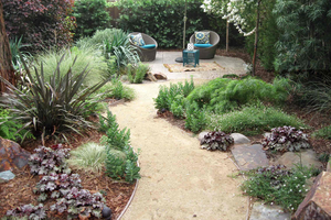 A winding path is able to make the space seem larger. Photo: Ketti Kupper