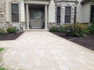 Concrete pavers come in a wide variety of colors. This walkway areas features Hera pavers from Techo-Bloc.