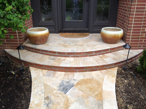 Travertine can often be found around pool deck areas, but can also brighten up a walkway.