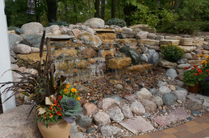 This waterfall, built into the woodland slope, adds a live element to the quiet oasis.