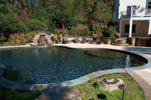 Hardscaping and plantings complement, rather than overwhelm, a water feature in this design.