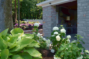 The outdoor kitchen visible here may have been the highest value-add on the project, but the series of raised beds and their plantings illustrate the company's broad skillset.