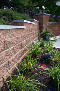 Extensive plantings on either side of a retaining wall, along with the wall itself, illustrate the company's attention to quality and detail.