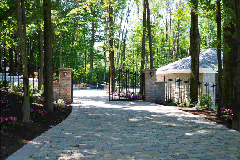 The hardscape work on this residential client's driveway, coupled with the landscaping around it, shows off the company's wide range of services.