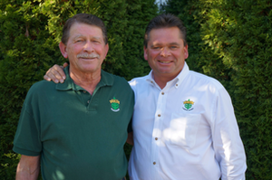 Richard Irvin, left, poses with his son Russell, who is working to ensure TDH Landscaping is around for another 50 years.