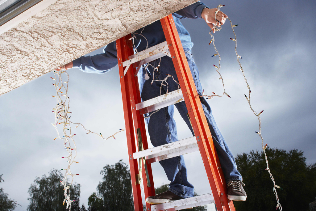 Don't rush when putting up lights, ladder safety comes first