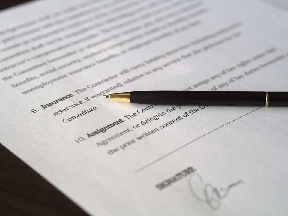 Paper with a Signature at the Bottom of the Page