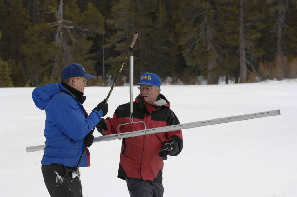 Snow surveyors working in the snow