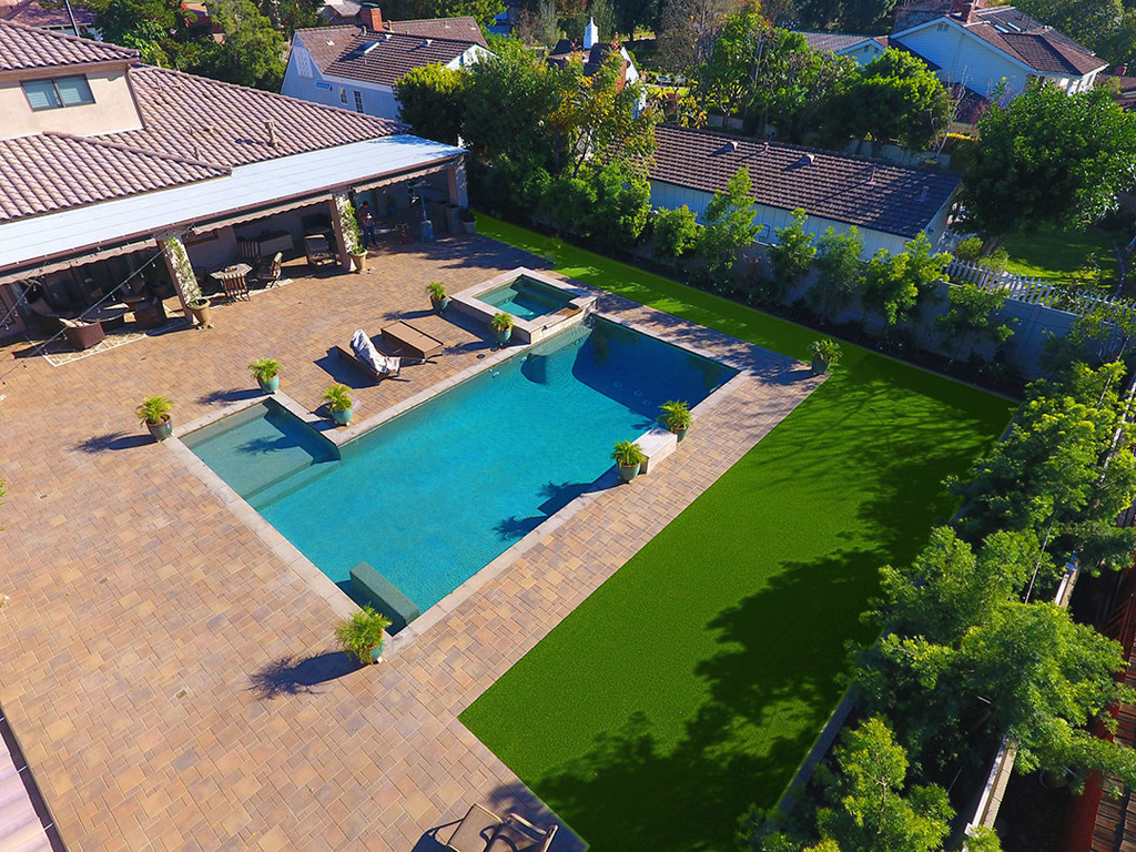 Hillside Pavers's Hardscape Surrounding Swimming Pool
