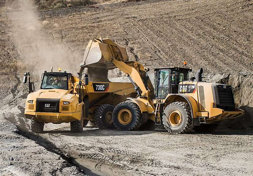 Cat 730C loaded up by Cat 972M