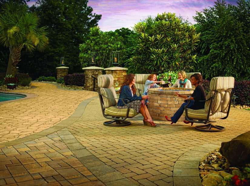 friends gather on landscaped patio