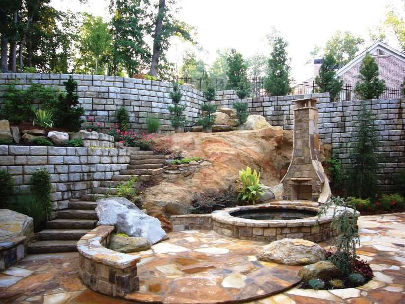 hardscaping with retaining wall in the backyard