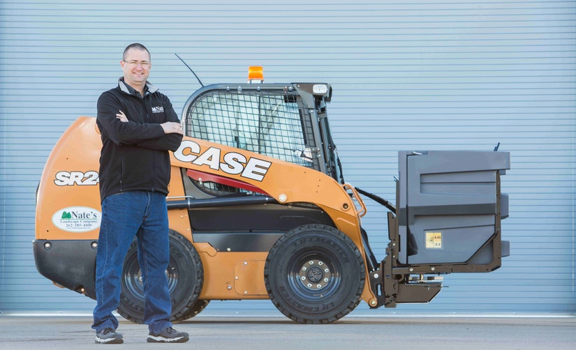 man with case equipment and boss snowplow attachment