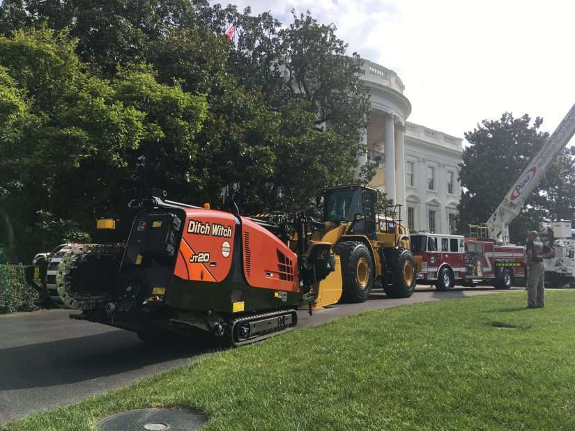 ditch witch machinery in landscaped yard
