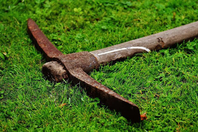 pickaxe-in-grass