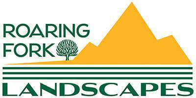 logo for roaring fork landscapes with mountains and tree