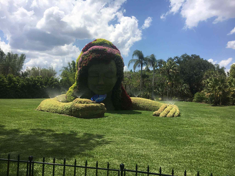large topiary of girl with butterfly