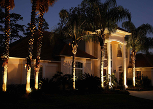 beautiful home with front yard lit with LED lighting