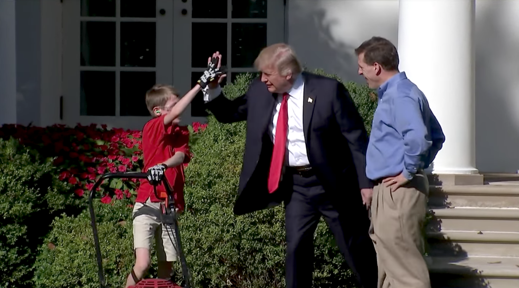 Donald Trump with Frank Giaccio after mowing the white house lawn