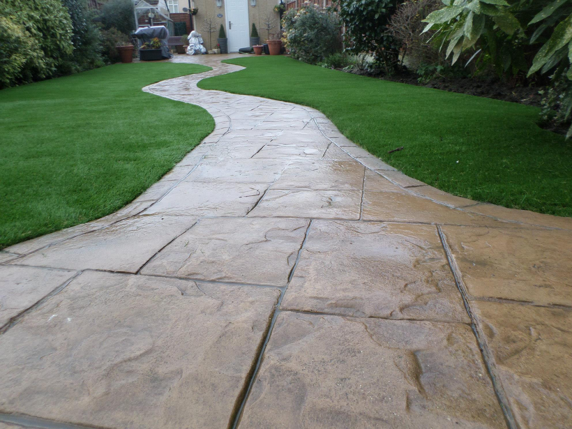 synthetic turf and stone path leading to home