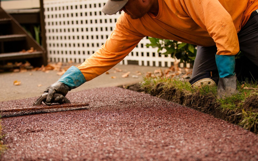worker smooths out porous pave