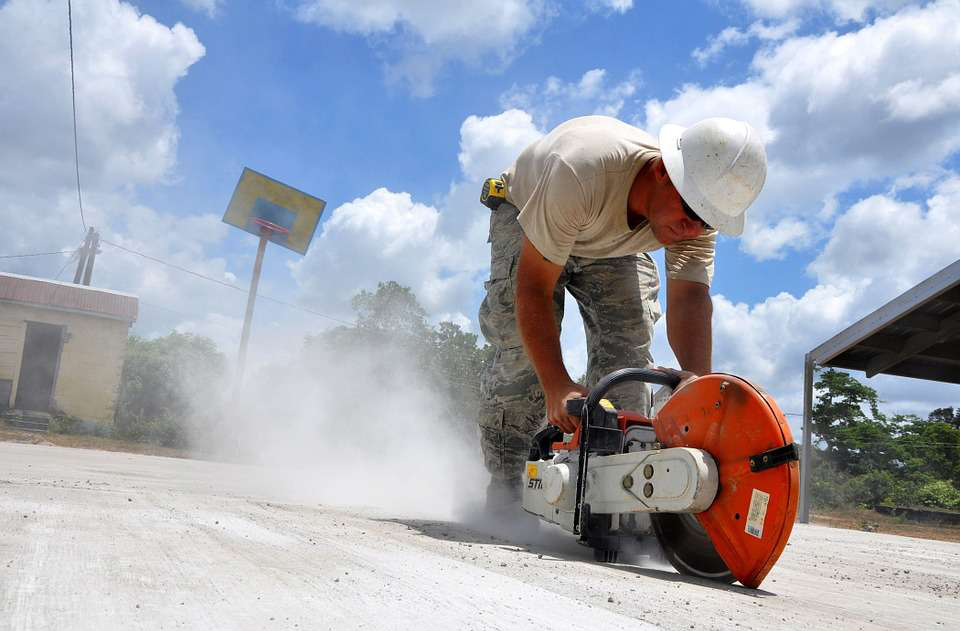 worker using sthil saw on concrete