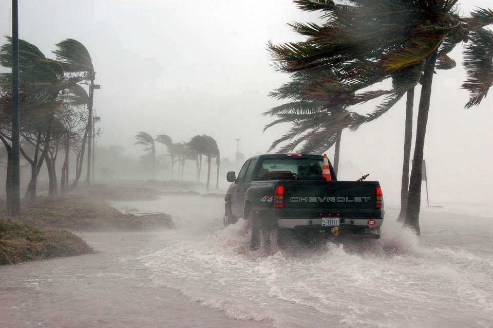 chevrolet truck driving through hurricane