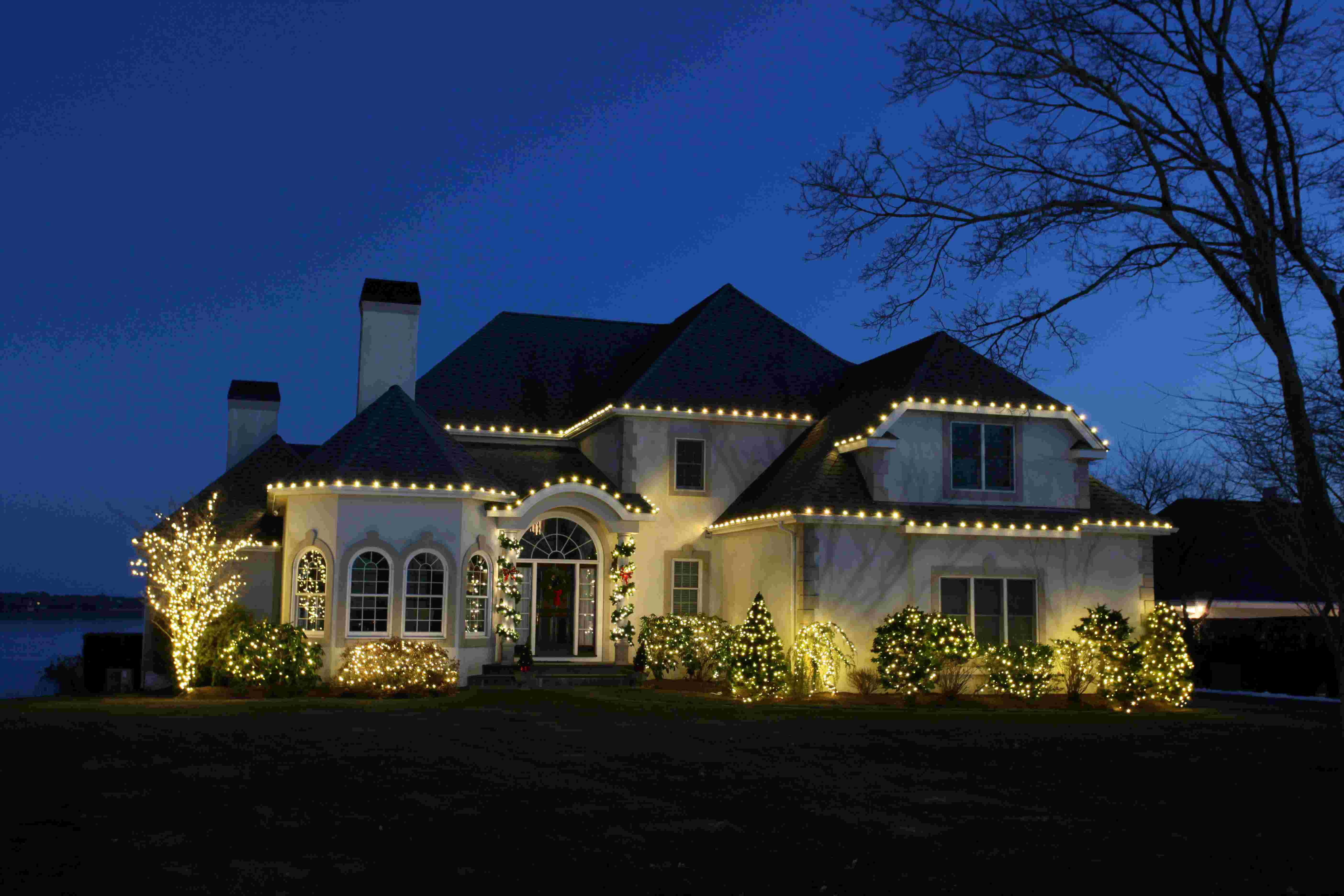 beautifully lit home with white christmas lights