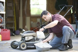 a-man-working-on-his-lawnmower-