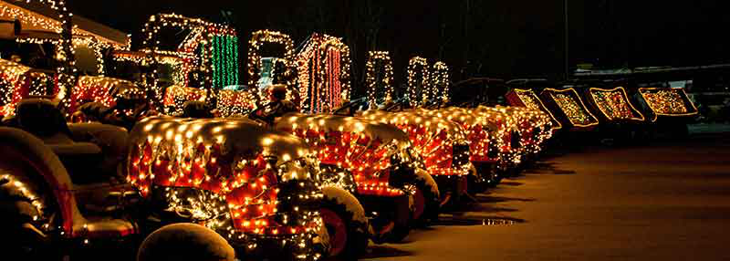 tractors covered in Christmas lights
