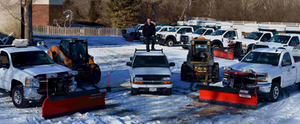 trucks getting ready to plow snow