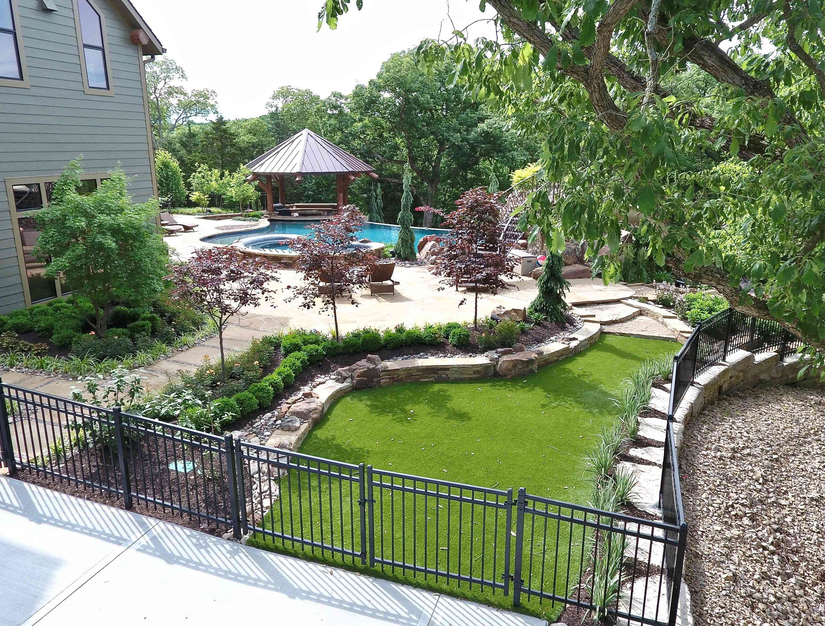 artificial grass landscaped in a residential back yard