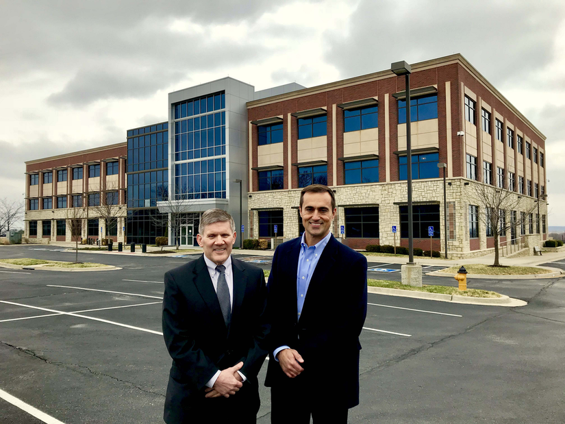 Pictured Left to right: PBI-Corporation president and CEO Don Chew and PBI-Corporation CFO Andrew Peck standing in front of PBI-Gordon Building