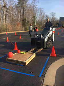 Students driving mini-track loader
