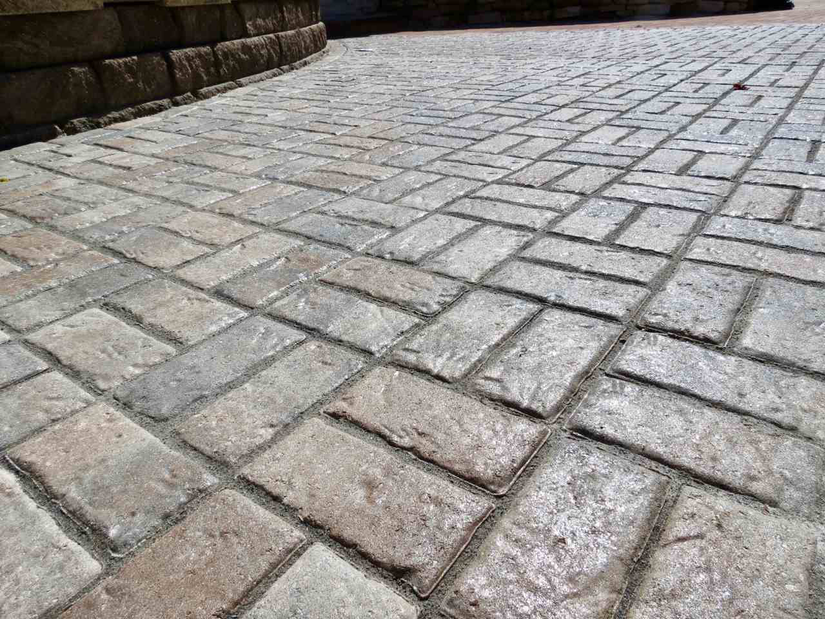 close up of brick pavers that have been pretreated by Black Diamond Coatings