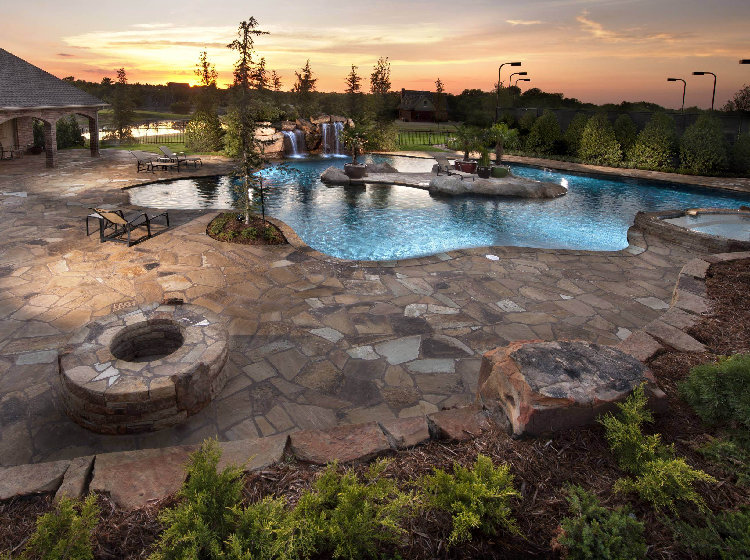 Fancy Landscape Design By Caviness Landscape Design, Glistening Blue Swimming  Pool With Rock Water Falls