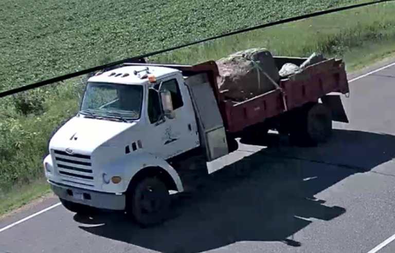 Landscaping truck with boulders in the back