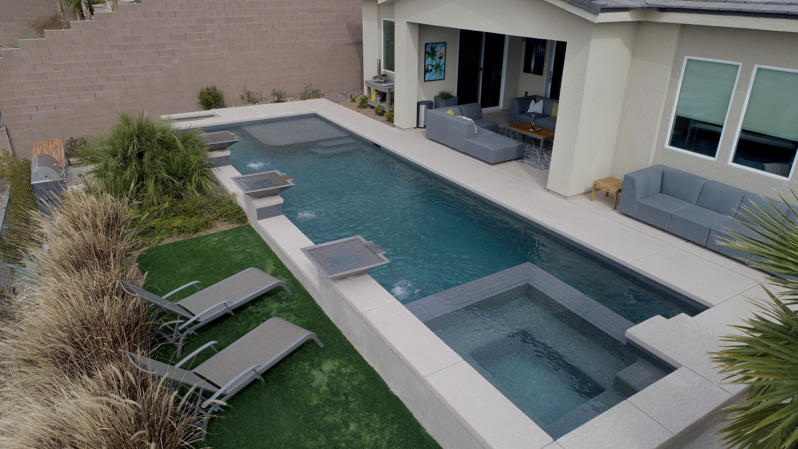 outdoor living space with backyard swimming pool