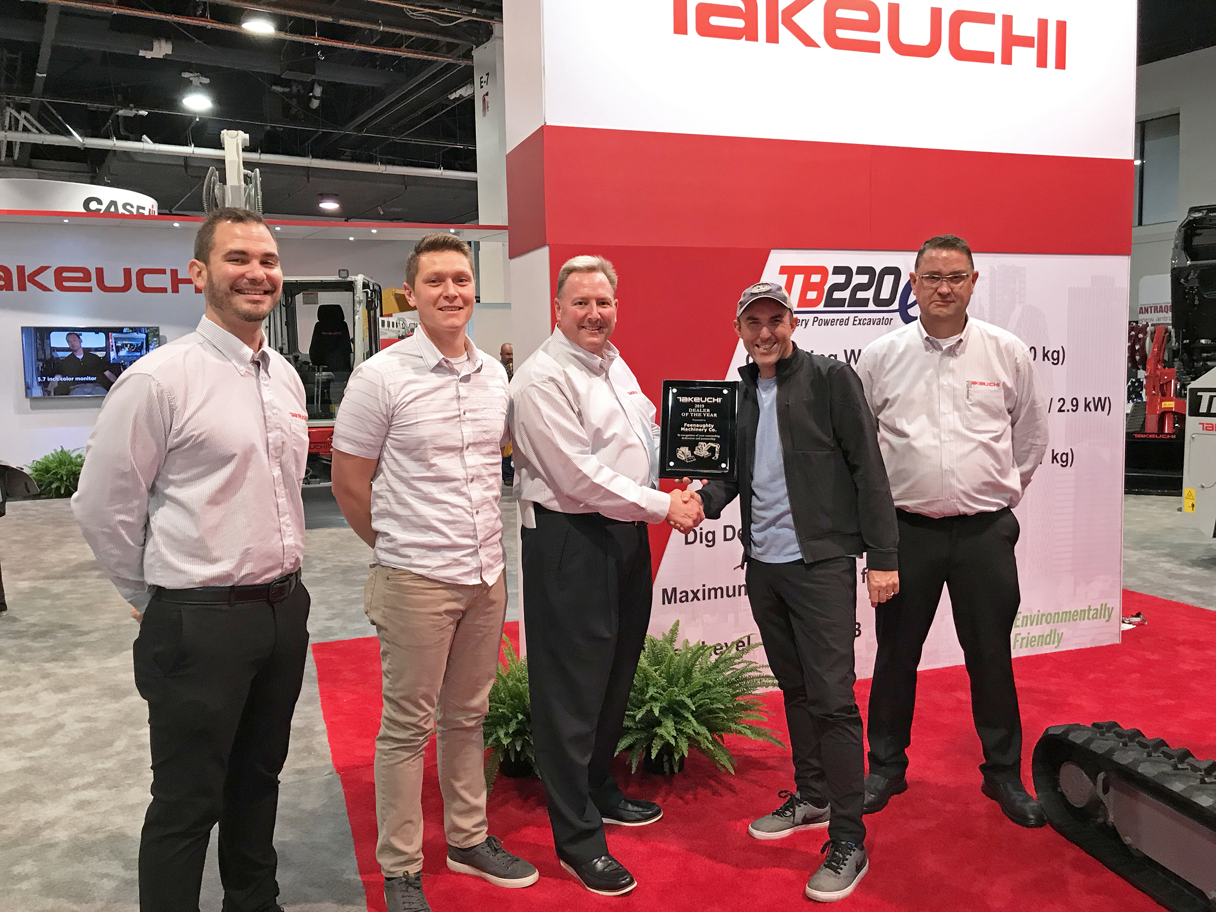 Randy Harris, Feenaughty president, accepts takeuchi dealer of the year award