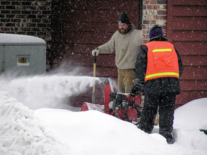snow blower being used for snow removal