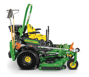john deere commercial zero turn mower with tools and other landscaping equipment