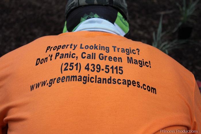 Landscaper wearing Green Magic Landscapes t-shirt