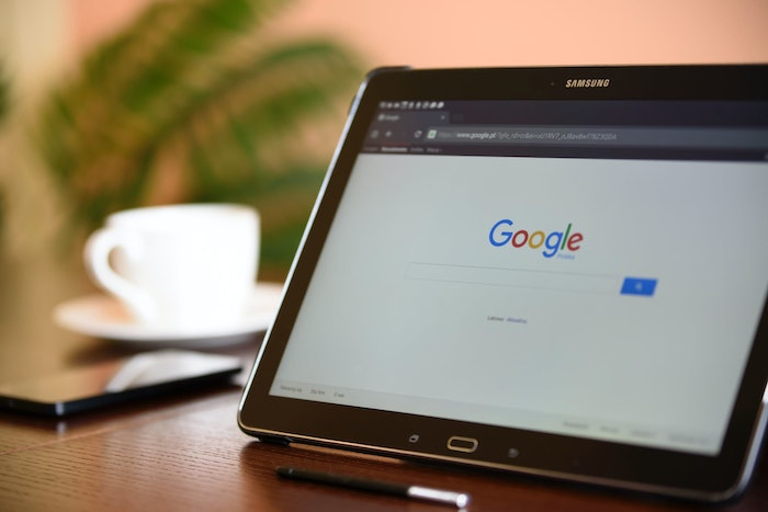 A Samsung tablet with Google pulled up sitting on a table.